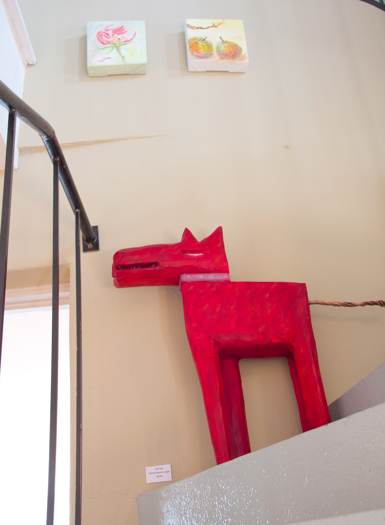 Red dog painted wood and copper sculpture